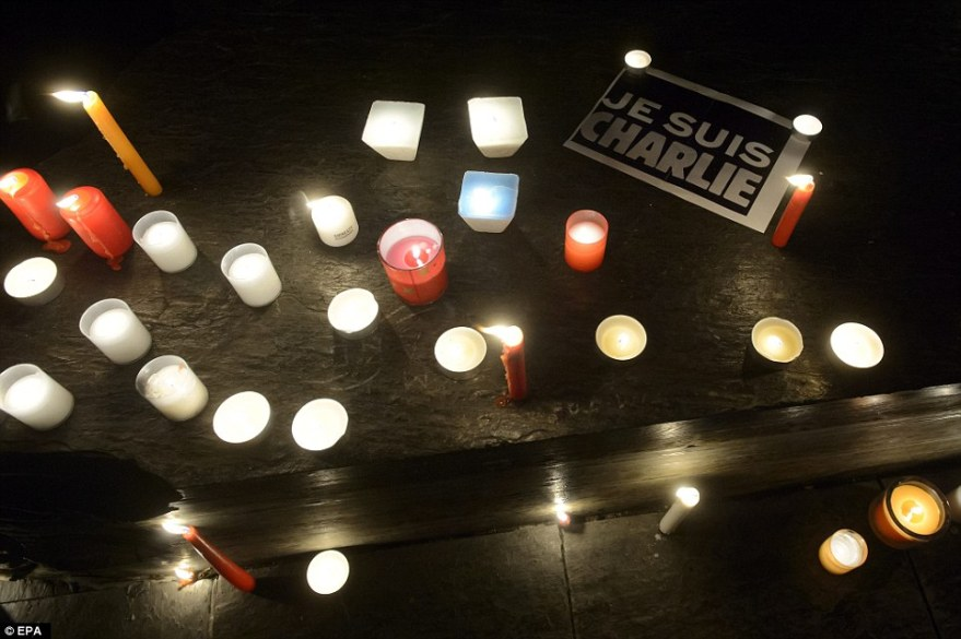 247C7DAC00000578-2900835-Geneva_Candles_and_a_Je_Suis_Charlie_mark_another_peaceful_prote-a-12_1420669628125